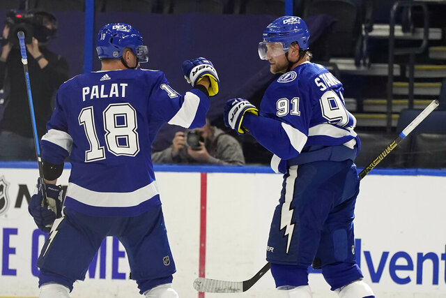 Tampa Bay Lightning center Steven Stamkos (91) celebrates his goal against the Chicago Blackhawks with left wing Ondrej Palat (18) during the third period of an NHL hockey game Friday, Jan. 15, 2021, in Tampa, Fla. (AP Photo/Chris O'Meara)