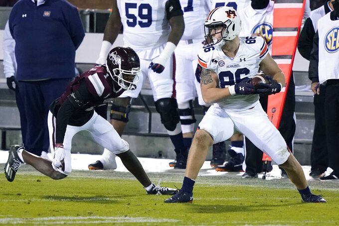 Auburn tight end Luke Deal (86) protects a pass reception next to Mississippi State cornerback Martin Emerson Jr. (1) during the second half of an NCAA college football game Saturday, Dec. 12, 2020, in Starkville, Miss. (AP Photo/Rogelio V. Solis)