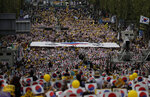 Thousands of supporters of the beleaguered South Korean Justice Minister Cho Kuk rally in front of Seoul Central District Prosecutors' Office in Seoul, South Korea, Saturday, Oct. 5, 2019. (AP Photo/Lee Jin-man)