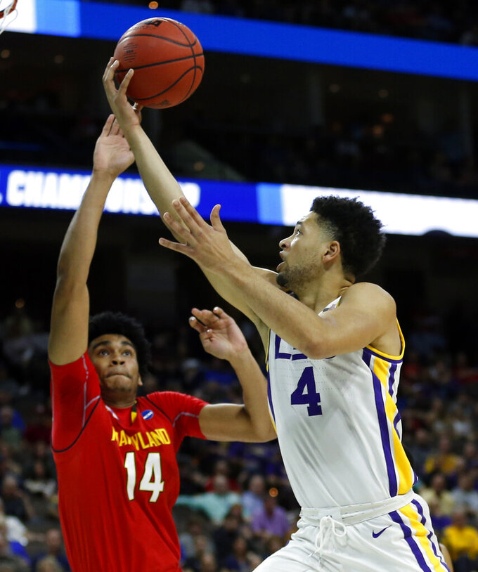 LSU's Skylar Mays (4) makes a shot over Maryland's Ricky Lindo Jr. (14) during the first half of a second-round game in the NCAA men's college basketball tournament in Jacksonville, Fla., Saturday, March 23, 2019. (AP Photo/Stephen B. Morton)