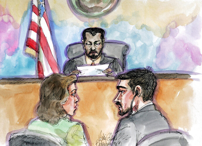FILE - In this April 25, 2006 file artist's sketch, terror probe defendant Hamid Hayat, right, and his attorney Wazhma Mojaddidi, left, listen as U.S. District Judge Garlend E. Burrell Jr. reads the jury's guilty verdict at the federal courthouse in Sacramento, Calif. A federal magistrate has recommended overturning the controversial conviction of Hayat, accused of attending a terrorist training camp in Pakistan and plotting an attack in the United States. U.S. Magistrate Judge Deborah Barnes said Friday, Jan. 11, 2019, that Hayat, a young cherry picker from Lodi, likely never would have been convicted in 2006 were it not for the inexperience of his defense attorney. (AP Photo/Vicki Ellen Behringer, File)