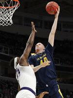 UC Irvine forward Collin Welp, right, shoots over Kansas State forward Austin Trice during the second half of a first-round game in the NCAA men's college basketball tournament Friday, March 22, 2019, in San Jose, Calif. (AP Photo/Chris Carlson)