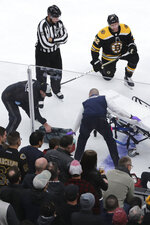 Boston Bruins right wing David Backes, right, watches as medical workers attend to Ottawa Senators right wing Scott Sabourin, who was injured on a play with Backes, during the first period of an NHL hockey game in Boston, Saturday, Nov. 2, 2019. (AP Photo/Charles Krupa)