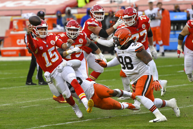 Kansas City Chiefs quarterback Patrick Mahomes (15) throws a pass in front of Cleveland Browns defensive tackle Sheldon Richardson, right, during the second half of an NFL divisional round football game, Sunday, Jan. 17, 2021, in Kansas City. (AP Photo/Reed Hoffmann)