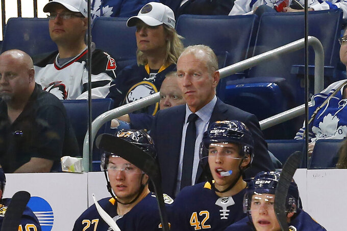 FILE - Buffalo Sabres coach Ralph Krueger watches during the third period of the team's NHL preseason hockey game against the Toronto Maple Leafs in Buffalo, N.Y., in this Saturday, Sept. 21, 2019, file photo. The Sabres fired coach Ralph Krueger on Wednesday, March 17, 2021.  (AP Photo/Jeffrey T. Barnes, File)