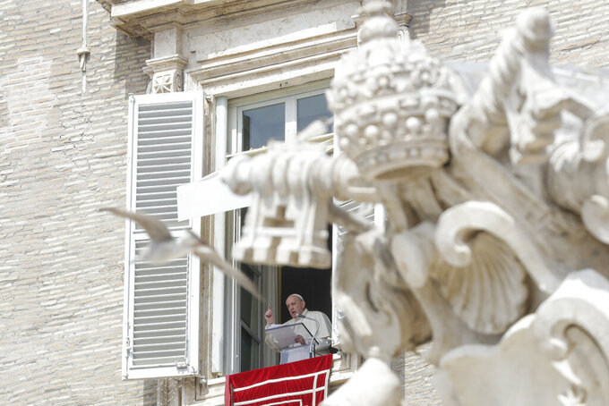 Pope Francis delivers his blessing as he recites the Regina Caeli noon prayer from the window of his studio overlooking St.Peter's Square, at the Vatican, Sunday, April 18, 2021. Pope Francis said he is happy to be back greeting the faithful in St. Peter's Square faithful for his traditional Sunday noon blessing after weeks of lockdown measures.  (AP Photo/Andrew Medichini)