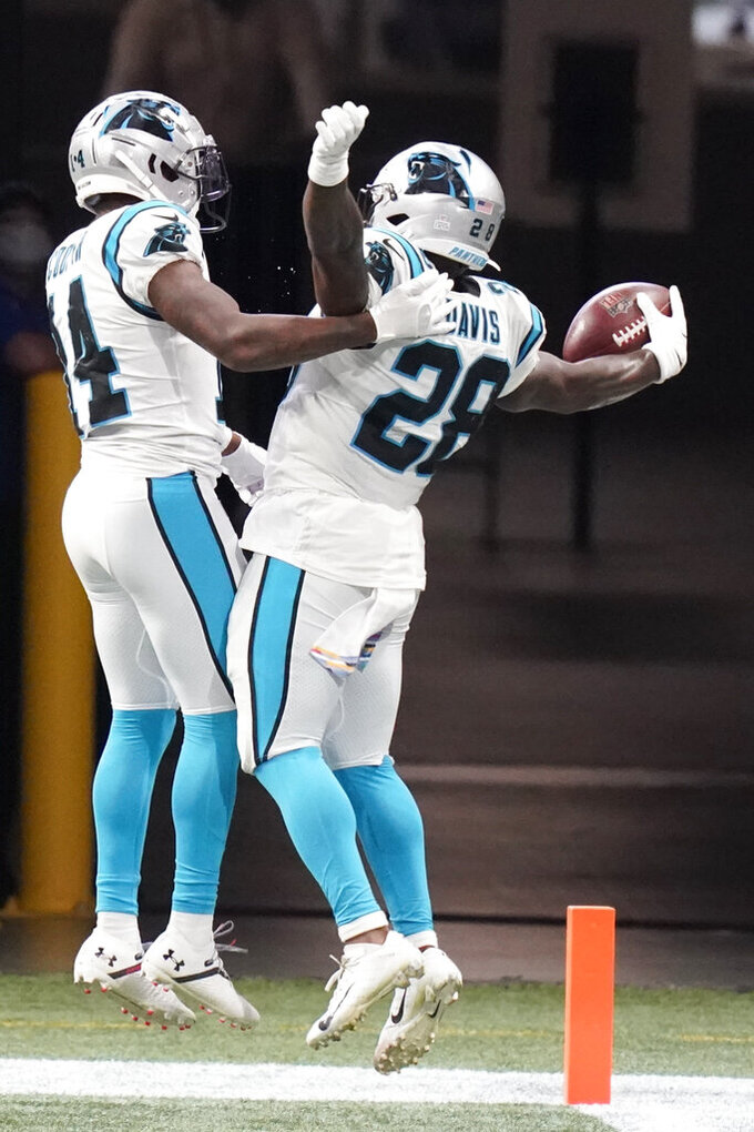 Carolina Panthers running back Mike Davis (28) celebrates his touchdown with Carolina Panthers wide receiver Pharoh Cooper (14) against the Atlanta Falcons during the first half of an NFL football game, Sunday, Oct. 11, 2020, in Atlanta. (AP Photo/Brynn Anderson)