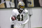 New Orleans Saints running back Alvin Kamara (41) runs a drill during NFL football training camp in Metairie, La., Tuesday, Aug. 17, 2021. (AP Photo/Derick Hingle)