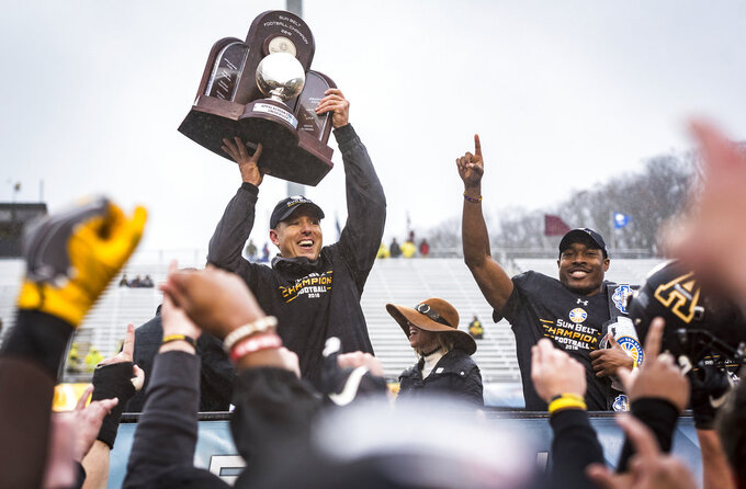 Appalachian State head coach Scott Satterfield celebrates after the Mountaineers won the Sunbelt Championship on Saturday, Dec. 1, 2018 in Boone, N.C.  (Andrew Dye/The Winston-Salem Journal via AP)