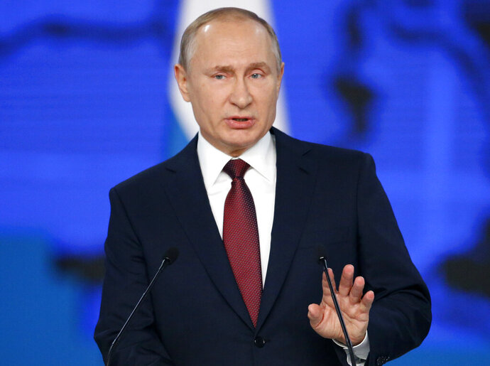 FILE - In this file photo taken on Wednesday, Feb. 20, 2019, Russian President Vladimir Putin delivers a state-of-the-nation address in Moscow, Russia. Asked about the allegations of collusion between Trump's campaign and Russia, Putin has charged that the continuing U.S. political infighting reflects a