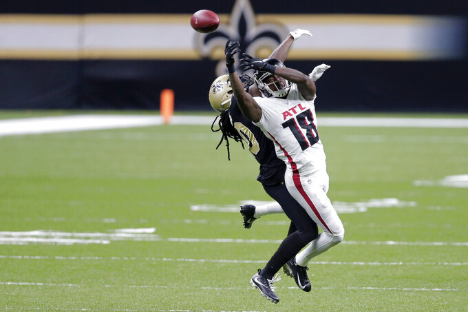 New Orleans Saints cornerback Janoris Jenkins breaks up a pass intended for Atlanta Falcons wide receiver Calvin Ridley (18) in the second half of an NFL football game in New Orleans, Sunday, Nov. 22, 2020. The Saints won 24-9. (AP Photo/Brett Duke)