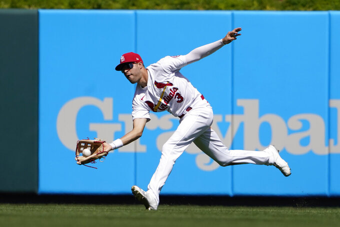 St. Louis Cardinals center fielder Dylan Carlson catches a fly ball by Los Angeles Dodgers' Max Muncy during the fifth inning of a baseball game Thursday, Sept. 9, 2021, in St. Louis. (AP Photo/Jeff Roberson)
