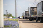 Police responded to a shooting at Kent Moore Cabinets on Thursday, April 8, 2021, in Bryan, Texas. One person was killed and several people were wounded Thursday in the wake of a shooting at a cabinet-making business in Bryan, Texas, authorities said, and a state trooper was later shot during a manhunt that resulted in the suspected shooter being taken into custody. (Cassie Stricker/College Station Eagle via AP)