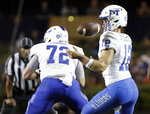 Middle Tennessee quarterback Brent Stockstill (12) bobbles a snap against Vanderbilt in the first half of an NCAA college football game Saturday, Sept. 1, 2018, in Nashville, Tenn. Stockstill kept possession of the ball. (AP Photo/Mark Humphrey)