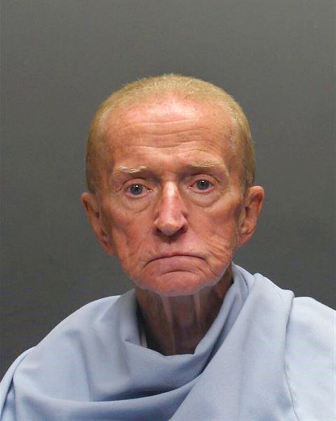 FILE - This Jan. 14, 2018, photo released by the Tucson Police Department shows 81-year-old Robert Francis Krebs, who was charged with robbing a credit union in Tucson, Ariz. A judge has ruled Krebs, who claimed to have symptoms of Alzheimer's disease, is mentally fit to stand trial. (Tucson Police Department via AP, File)
