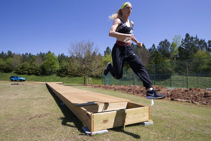 FILE - In this April 14, 2020, file photo, Olympic pole vaulting silver medalist Sandi Morris runs on the vaulting pit she is building with her father in Greenville, S.C. The coronavirus crisis has forced many athletes to be creative as they try to continue their training. (AP Photo/John Bazemore, File)