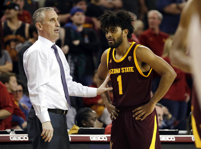 "FILE - In this Jan. 26, 2019, file photo, Arizona State coach Bobby Hurley, left, talks to guard Remy Martin during the second half of the team's NCAA college basketball game against Southern California in Los Angeles. The Sun Devils won their first NCAA Tournament game in a decade by beating St. John's in the First Four last year before losing to Hurley's former team, Buffalo. Now they want more. ""Even though we've done a good amount, I'm still not satisfied, I still want to make it further,"" Martin said. ""For those guys that left, they did great but we're here now and we've got to figure out how to win."" (AP Photo/Marcio Jose Sanchez, File)"