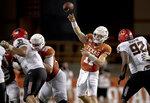 Texas quarterback Sam Ehlinger (11) throws the ball against Oklahoma State during an NCAA college football game on Saturday, Sept. 21, 2019, in Austin, Texas. (Nick Wagner/Austin American-Statesman via AP)