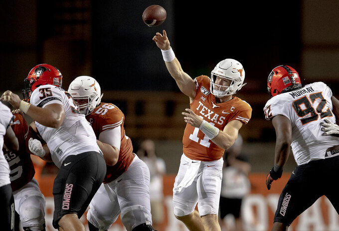 Texas quarterback Sam Ehlinger (11) throws the ball against Oklahoma State during an NCAA college football game on Saturday, Sept. 21, 2019, in Austin, Texas. (Nick Wagner/Austin American-Statesman via AP)