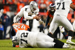 Oakland Raiders quarterback Derek Carr, above, is sacked by Denver Broncos outside linebacker Von Miller during the second half of an NFL football game Sunday, Dec. 29, 2019, in Denver. (AP Photo/Jack Dempsey)