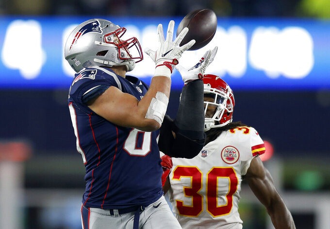 FILE - In this Sunday, Oct. 14, 2018, file photo, New England Patriots tight end Rob Gronkowski, left, catches a pass in front of Kansas City Chiefs safety Josh Shaw (30) during the second half of an NFL football game in Foxborough, Mass. (AP Photo/Michael Dwyer, File)