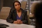 """This image released by Hulu shows Rosario Dawson in a scene from """"Dopesick,"""" an eight-part miniseries about America's opioid crisis, premiering Wednesday with three episodes. (Gene Page/Hulu via AP)"""