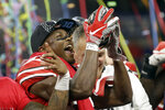 Ohio State wide receiver Terry McLaurin holds the trophy early Sunday, Dec. 2, 2018, after defeating Northwestern 45-24 in the Big Ten championship NCAA college football game in Indianapolis. (AP Photo/AJ Mast)