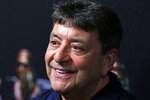 FILE - In this Aug. 5, 2016, file photo Pro Football Hall of Fame 2016 inductee Edward J. DeBartolo, Jr., talks with reporters in Canton, Ohio. President Donald Trump pardoned DeBartolo, former San Francisco 49ers owner convicted in gambling fraud scandal. (AP Photo/Gene J. Puskar, File)