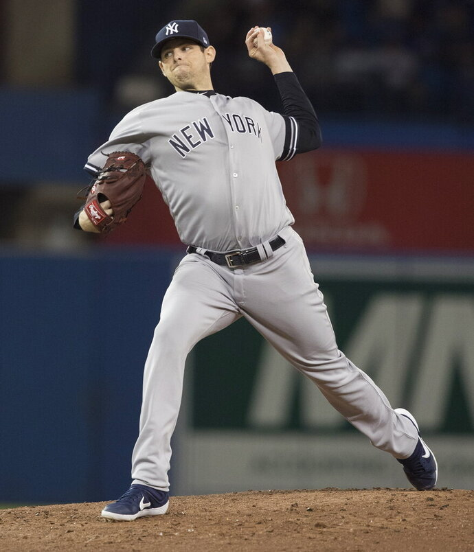 New York Yankees pitcher Jordan Montgomery throws against the Toronto Blue Jays during the second inning of a baseball game in Toronto, Sunday, Sept. 15, 2019. (Fred Thornhill/The Canadian Press via AP)