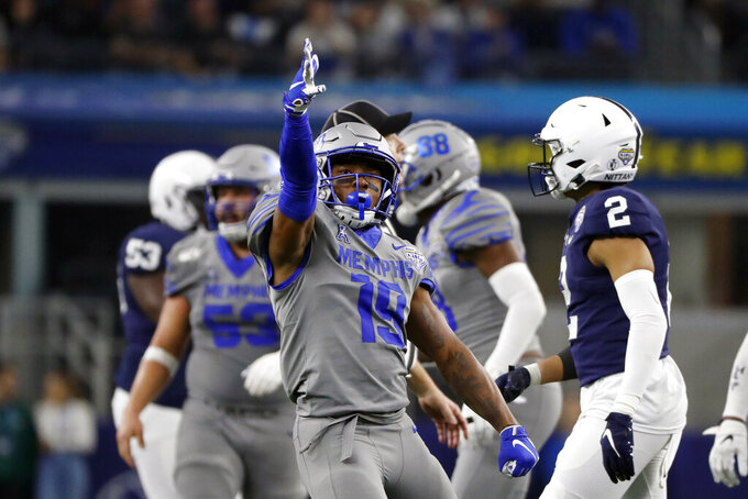 FILE - Memphis running back Kenneth Gainwell (19) reacts after a first down run during the second half of the NCAA Cotton Bowl college football game against Penn State in Arlington, Texas, in this Saturday, Dec. 28, 2019, file photo. Gainwell had every intention of playing football with the Memphis Tigers last fall, going through fall practice. The funeral for an uncle, the fourth member of his family to die of COVID-19 made opting out of the season the best decision for Gainwell. (AP Photo/Roger Steinman, File)