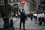 Police look for people who did not get off the street after the start of curfew Tuesday, June 2, 2020, in New York, during a protest over the death of George Floyd. Floyd died after being restrained by Minneapolis police officers May 25. (AP Photo/Wong Maye-E)