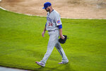 Chicago Cubs starting pitcher Jon Lester heads to the dugout after being pulled by manager David Ross during the fourth inning of the team's baseball game against the Chicago White Sox in Chicago, Saturday, Sept. 26, 2020. (AP Photo/Nam Y. Huh)
