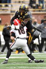 Missouri defensive lineman Trajan Jeffcoat, top, sacks Georgia quarterback JT Daniels during the first half of an NCAA college football game Saturday, Dec. 12, 2020, in Columbia, Mo. (AP Photo/L.G. Patterson)