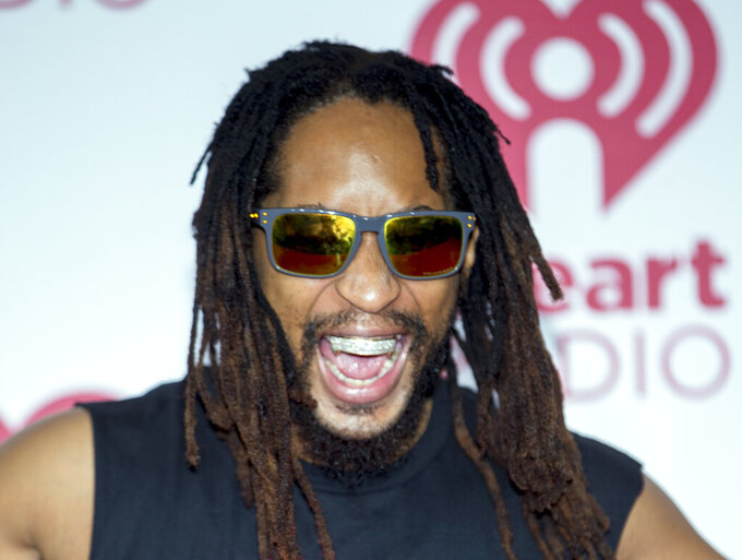 "FILE - In this Sept. 20, 2014, file photo, Lil Jon arrives at the iHeart Radio Music Festival at The MGM Grand Garden Arena in Las Vegas. Lil Jon says he understands Maroon 5's decision to cancel its news conference to discuss the band's Super Bowl halftime performance with reporters. Maroon 5, with frontman Adam Levine, was supposed to speak with the media Thursday, Jan. 31, 2019, to promote their Super Bowl 53 appearance, but decided to cancel and let their ""show do the talking.""  (Photo by Andrew Estey/Invision/AP, File)"