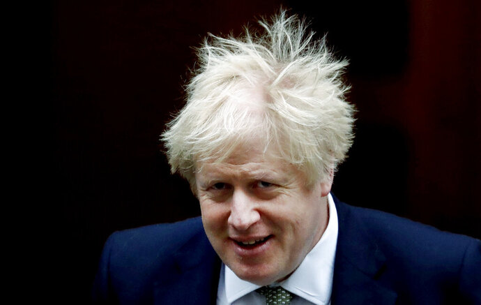 FILE In this file photo dated Thursday, Dec. 19, 2019, Britain's Prime Minister Boris Johnson leaves Downing Street for the State Opening of Parliament by Queen Elizabeth II, in the House of Lords at the Palace of Westminster in London.  Charismatic Prime Minister Johnson's larger-than-expected margin of victory in the December general election may give him a chance to consolidate power during the coming 2020 year. (AP Photo/Frank Augstein, FILE)