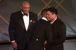 "FILE - In this March 24, 1997, file photo, George Foreman, left, looks on as Will Smith, center, gives Muhammad Ali a hug after Ali And Foreman made an appearance on stage after the film ""When We Were Kings"" was awarded Best Documentary Feature at the 69th Annual Academy Awards in Los Angeles. The Associated Press has compiled a list of the best sports movies ever made — a one-of-a-kind AP Top 25. Two documentaries made the rankings: ""Hoop Dreams"" at No. 14 and ""When We Were Kings,"" tied for No. 21. (AP Photo/Susan Sterner, File)"