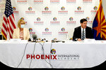 Arizona Gov. Doug Ducey, right, and U.S. Secretary of Education Betsy DeVos attend a roundtable discussion Thursday, Oct. 15, 2020, at the Phoenix International Academy in Phoenix. (AP Photo/Matt York)