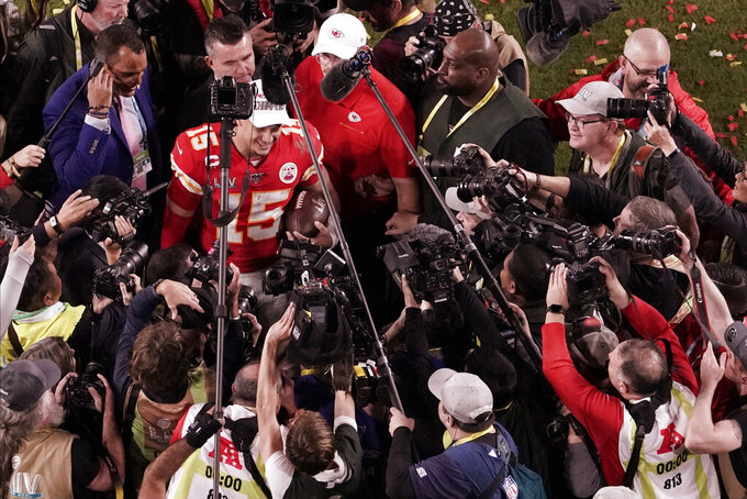 Kansas City Chiefs quarterback Patrick Mahomes (15) is surrounded by media after his team won the NFL Super Bowl 54 football game against the San Francisco 49ers, Sunday, Feb. 2, 2020, in Miami Gardens, Fla. The Chiefs' defeated the 49ers 31-20. (AP Photo/Morry Gash)