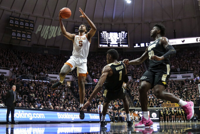 Texas forward Royce Hamm Jr. (5) shoots after making contact with Purdue forward Aaron Wheeler (1) in the first half of an NCAA college basketball game in West Lafayette, Ind., Saturday, Nov. 9, 2019. (AP Photo/AJ Mast)