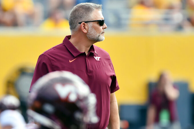 Virginia Tech head coach Justin Fuente watches before  an NCAA college football game against West Virginia in Morgantown, W.Va., Saturday, Sept. 18, 2021. (AP Photo/William Wotring)