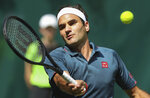 Switzerland's Roger Federer plays a forehand during his ATP Tour Singles, Men, Round of 16 tennis match against Canada's Felix Auger-Aliassime in Halle, Germany, Wednesday, June 16, 2021. (Friso Gentsch/dpa via AP)