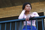 FILE - This March 31, 2020 photo shows Jade Brooks at her apartment in Boston.  Brooks and her family have counted on an eviction moratorium in Massachusetts to get them through the pandemic. Still, 22-year-old Brooks worries: How long will it last? Brooks' mother hasn't found find full-time work since losing her insurance-company job. And Brooks doesn't get paid enough as a hospital switchboard operator to cover rent _ recently raised to $2,075 monthly _ for their two-bedroom Boston apartment.(AP Photo/Elise Amendola)