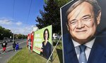 People walk past election posters of the three chancellor candidates, from right, Armin Laschet, Christian Democratic Union (CDU), Annalena Baerbock, German Green party (Die Gruenen) and Olaf Scholz, Social Democratic Party (SPD), at a street in Gelsenkirchen, Germany, Thursday, Sept. 23, 2021 three days before the General election on Sunday, Sept. 26, 2021. (AP Photo/Martin Meissner)