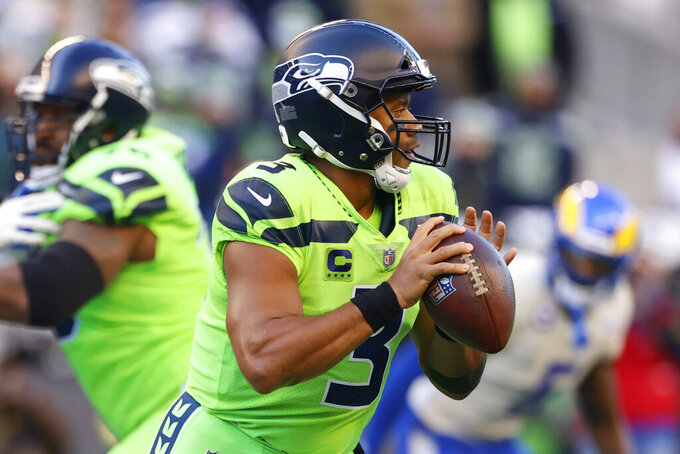 Seattle Seahawks quarterback Russell Wilson (3) passes against the Los Angeles Rams during the first half of an NFL football game, Thursday, Oct. 7, 2021, in Seattle. (AP Photo/Craig Mitchelldyer)