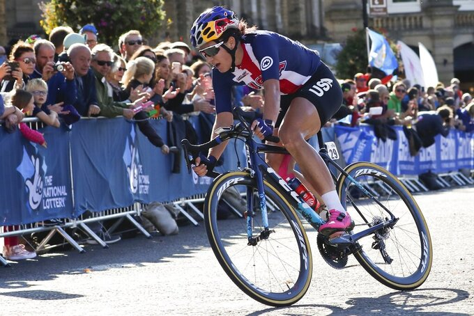 """FILE - United States' Chloe Dygert pedals during the women elite race at the road cycling World Championships in Harrogate, England, in this Saturday, Sept. 28, 2019, file photo. The men's and women's road races kick off the cycling program at every Summer Olympics. """"Everybody in the world is trying to figure out how to beat the Dutch girls,"""" said Jim Miller, the high performance director for USA Cycling. (AP Photo/Manu Fernandez, File)"""