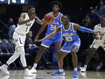 California's Darius McNeill, left, passes the ball away from UCLA's Prince Ali (23) and Jalen Hill (24) during the first half of an NCAA college basketball game Wednesday, Feb. 13, 2019, in Berkeley, Calif. (AP Photo/Ben Margot)