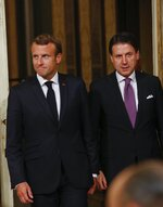 French President Emmanuel Macron, left, and Italian Premier Giuseppe Conte arrive to meet the media at Chigi Palace Premier office in Rome, Wednesday, Sept. 18, 2019. How Europe can better deal with migrant policies is slated to be a key matter for talks as French President Emmanuel Macron and Italy's Premier Giuseppe Conte meet in Rome Wednesday evening. (AP Photo/Domenico Stinellis)
