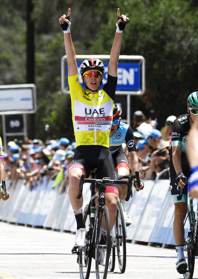 Tadej Pogacar, of Slovenia, celebrates as he wins the Tour of California bicycle race Saturday, May 18, 2019, in Pasadena, Calif. (AP Photo/Mark J. Terrill)