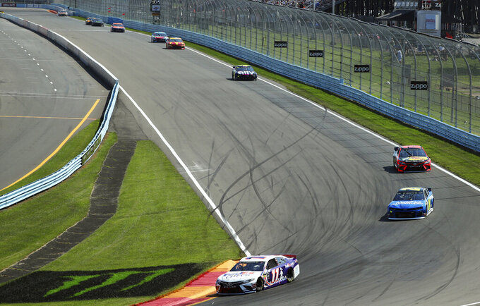 Denny Hamlin heads into Turn 1 during a NASCAR Cup Series auto race at Watkins Glen International, Sunday, Aug. 4, 2019, in Watkins Glen, N.Y. (AP Photo/John Munson)