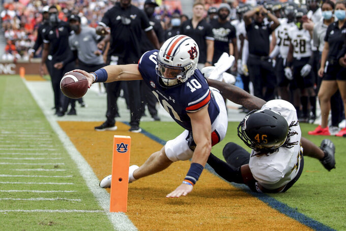 Auburn quarterback Bo Nix (10) comes up short as he stretches for the goal line as Alabama State linebacker Jake Howard (46) tackles him during the first half of an NCAA football game Saturday, Sept. 11, 2021, in Auburn, Ala. (AP Photo/Butch Dill)